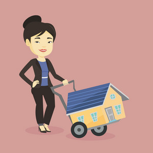 Happy asian woman pushing a shopping trolley with a house. Young smiling woman buying new house. Woman using shopping trolley to transport a small house. Vector flat design illustration. Square layout