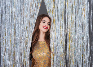 Happy attractive young woman standing over shining background