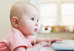 Happy baby girl using a laptop computer