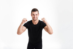 Happy bodybuilder in studio. isolated white background