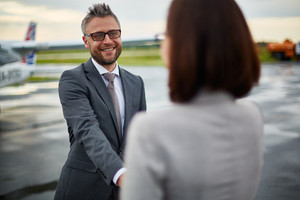 Happy businessman greeting his partner upon arrival