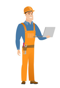 Happy caucasian builder using a laptop. Full length of young smiling builder working on a laptop. Cheerful builder holding a laptop. Vector flat design illustration isolated on white background.