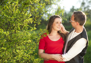 Happy couple is having romantic time in nature