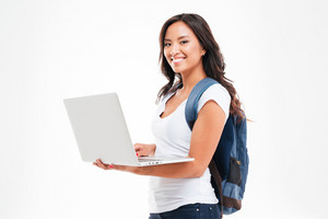 Happy cute asian student girl with backpack standing and holding laptop isolated on a white background