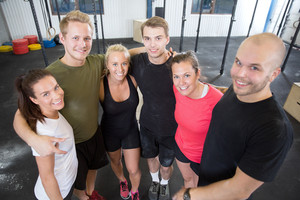 Happy fitness workout team at the gym