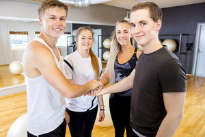 Happy fitness workout team holding hands