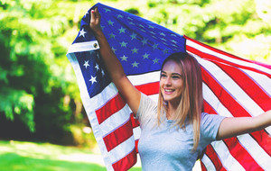 Happy girl with an American flag on the fourth of July