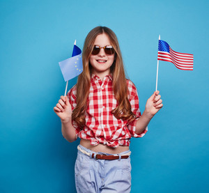 Happy girl with USA and EU flags