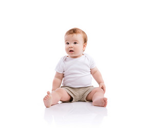 Happy little boy. Studio shot on white background.