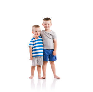 Happy little boys. Studio shot on white background.