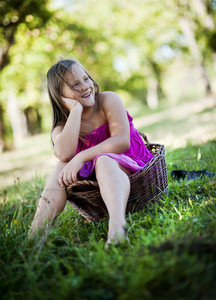 Happy little girl is playing in the green sunny park