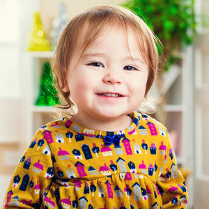 Happy little toddler girl with a nice smile