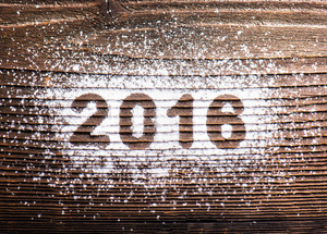 Happy new year composition. Studio shot on wooden background.