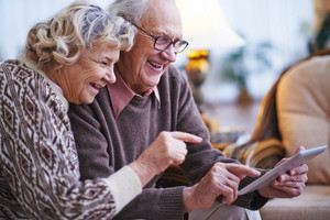 Happy seniors networking together at home