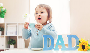 Happy toddler girl celebrating Father's Day