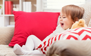 Happy toddler girl laughing in her living room