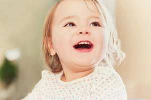 Happy toddler girl with a giant smile