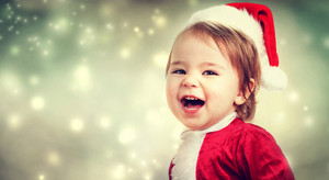 Happy Toddler girl with a Santa hat