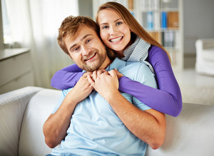 Happy young couple enjoying spending weekend together at home