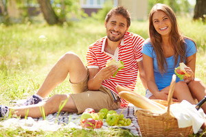 Happy young dates having picnic in the country