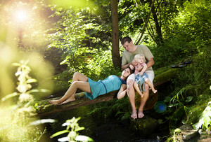 Happy young family spending time outdoor on a summer day