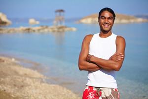 Happy young man enjoying vacation at summer resort