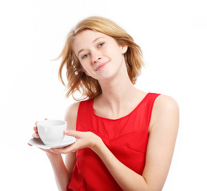 Happy young woman drinking coffee on white background