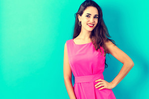Happy young woman on a blue background