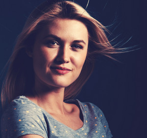 Happy young woman on a dark blue background