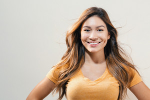 Happy young woman on a off white background