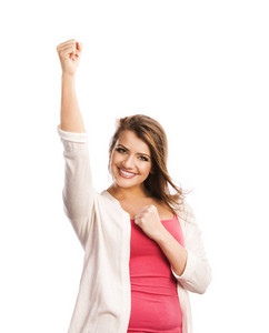 Happy young woman saying yes and gesturing while isolated on white background