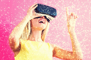 Happy young woman using a virtual reality headset with web concept