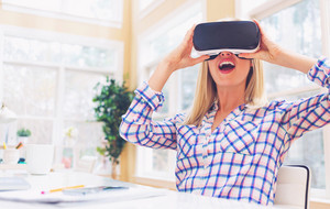 Happy young woman using a virtual reality headset