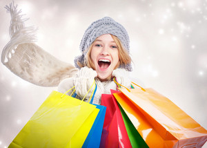 Happy Young Woman with Colorful Shopping Bag