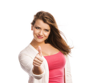 Happy young woman with thumbs up isolated on white background