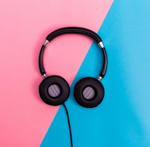 Headphones on a bright split duotone background