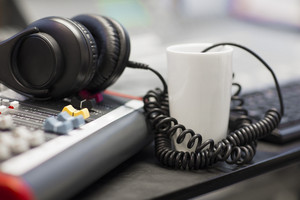 Headphones With Spiral Cord In Radio Studio