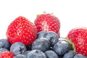 Healthy organic fresh blue and straw berry with water drops.