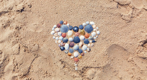 Heart shape made of seashells on the beach