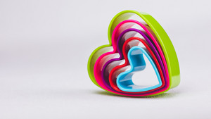 Heart shaped cookie cutter on white background