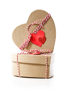 Heart shaped gift boxes with heart tags isolated on white background
