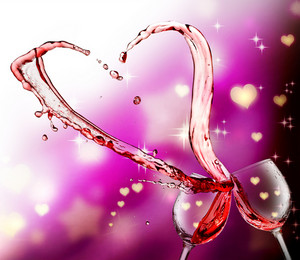 Heart splash from two glasses of red wine over abstract hearts light background