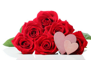 Heart tags with red roses over white background