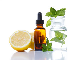 Herbal medicine dropper bottle with lemon and mint