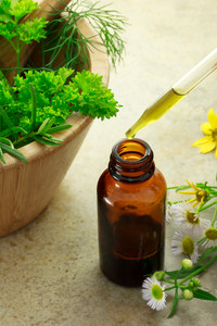 Herbal medicine with dropper bottle and wild flowers