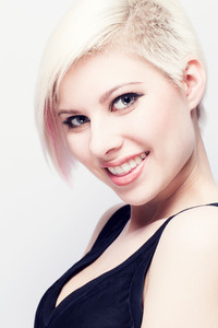 High key photo of a beautiful and glamorous young woman with creative hair style. Colored natural retouched.