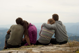 Hikers on the top of mountains are resting in the wild nature.