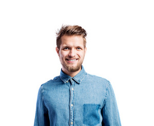 Hipster man in blue denim shirt, studio shot on white background, isolated