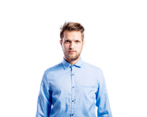 Hipster man in light blue long-sleeved shirt, studio shot on white background, isolated