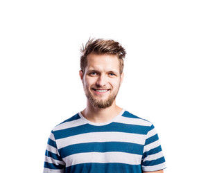 Hipster man in striped blue and white t-shirt, studio shot on white background, isolated